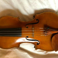 a beautiful early 20 century German Violin bears the label of Theodor Berger