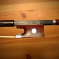 Carbon fiber 4/4 violin bow by ARCUS (model A-6, early series). Perfect condition.
